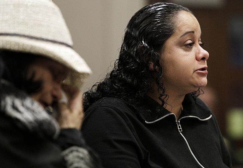 Mary Marrero right, the sister of Green River Killer victim Becky Marrero, reads a statement in court as her mother, Rebecca Marrero, left, wipes her eyes, Friday, Feb. 18, 2011, at the King County Regional Justice Center in Kent., Wash.