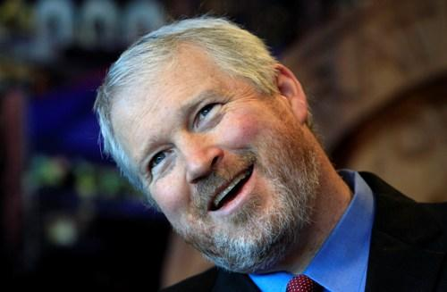 Seattle Mayor Mike McGinn tilts his head and smiles when asked about the replacement of the Alaskan Way Viaduct during a news conference about the city budget Oct. 11. As expected, McGinn on Thursday vetoed the city council plan for a waterfront tunnel.