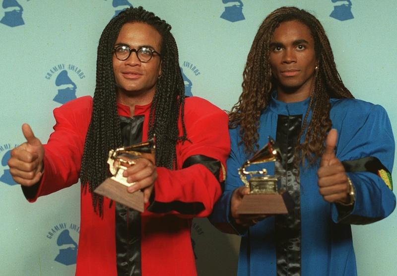 Rob Pilatus, left, and Fab Morvan of Milli Vanilli display their Grammys after winning the 1989 best new artist award in Los Angeles Feb. 21, 1990. They were later stripped of their award after being revealed as lip-synching poseurs.