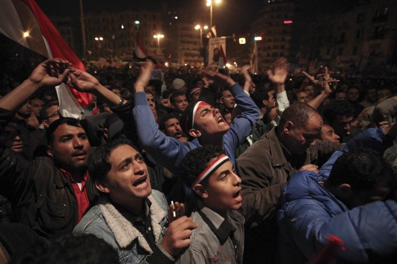 Anti-government protesters react with anger and sadness to Egyptian President Hosni Mubarak's televised statement to his nation in Tahrir Square in downtown Cairo, Egypt, Thurs., Feb. 10, 2011. Mubarak says he's handing some power to VP Omar Suleiman.