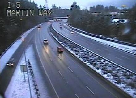 Snow falls on Olympia commuters during the 7 a.m. commute today. More is on the way for most of Western Washington.