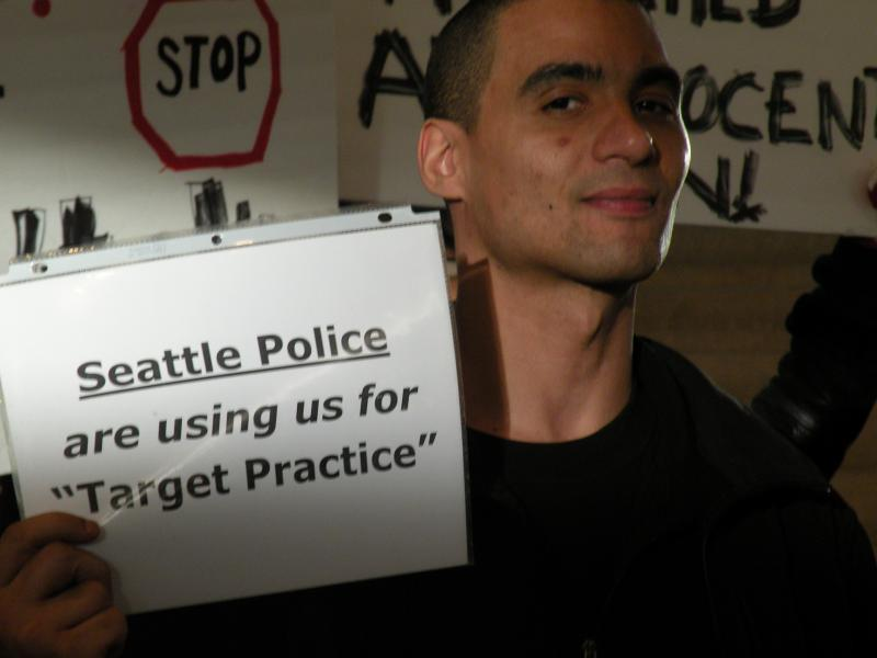 Anwar Peace was one of several hundred people gathered to honor John T. Williams and express their dismay that the police officer who killed him on a Seattle street last summer will not face criminal charges.