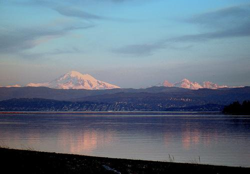 Bellingham Bay and Mt. Baker, as seen from Gooseberry Point, in Nov. 2008. Climate change is predicted to raise sea levels by as much as three feet by century's end. A new effort between Washington and British Columbia takes on climate change.