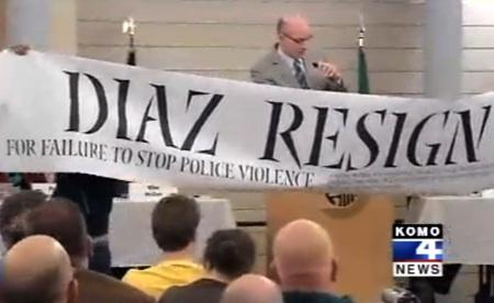 Protesters state their views on Seattle Police Chief John Diaz during a police accountability forum at city hall Thursday, Feb. 3, 2011,  in this image from KOMO-TV.