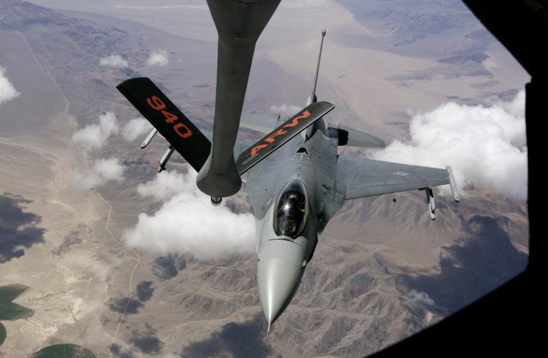 An F-16 from the California Air National Guard aligns with the boom from a Boeing, KC-135 Stratotanker. On Thursday, Boeing and Airbus' parent company EADS America submitted competing bids for the third time for a contract to build a new tanker. (File)