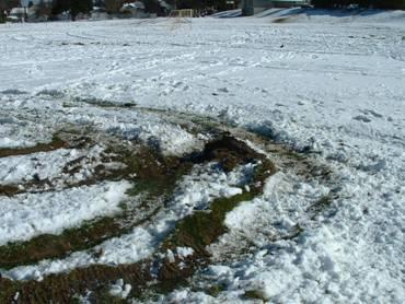 A close up look at the ruts in the Jane Clark Park sports field