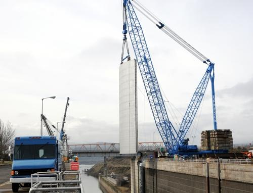 The second leaf of the new The Dalles downstream navigation lock gate is lowered into position on March 5.