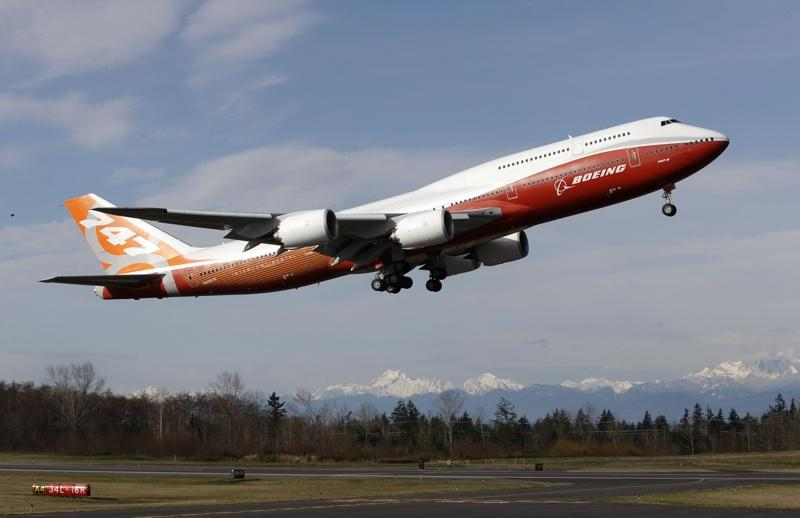 A Boeing 747-8 Intercontinental, Boeing's new passenger plane, takes off on its first flight, Sunday, March 20, 2011, at Paine Field in Everett, Wash.