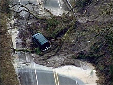 The driver and a passenger of this van were trapped for a brief time in a mudslide that covered busy Jovita Boulevard in Edgewood. No one was injured, according to KOMO News.