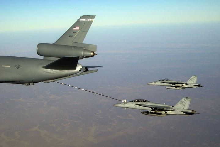 The outdated KC-10 refueling planes, like this one (left), will be replaced under Boeing's new contract.