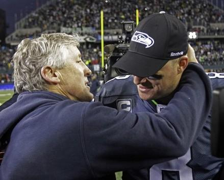 Love 'em or leave 'em: Matt Hasselbeck hugs coach Pete Carroll after the Seahawks beat the Saints in the NFC Wildcard playoff game Jan. 8, 2011.  Art Thiel says Hasselbeck will be a free agent whenever NFL players get a new contract.