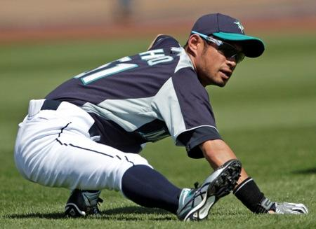 Mariners right fielder Ichiro Suzuki stretches before a spring training game in Arizona last month. Art Thiel says Ichiro is the only player to be starting in the same position he played last year, as the Mariners shuffle things around.