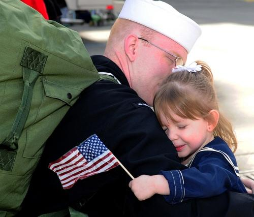 A Sailor greets his young daughter moments after arriving aboard the aircraft carrier USS Abraham Lincoln at Everett Thursday.