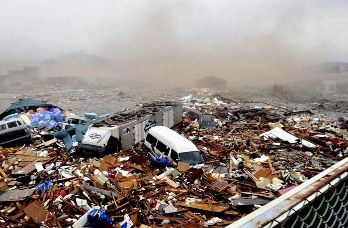 Cars and other Debris swept away by tsunami tidal waves are seen in Kesennuma in Miyagi Prefecture, northern Japan, after strong earthquakes hit the area Friday, March 11, 2011.