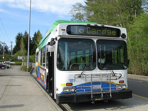 About a third of Pierce Transit's services are headed 'back to the garage' due to budget cuts announced Monday.