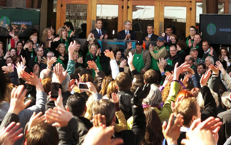 Starbucks baristas and employees at corporate headquarters celebrate new logo with CEO Howard Schultz on March 8, 2011.