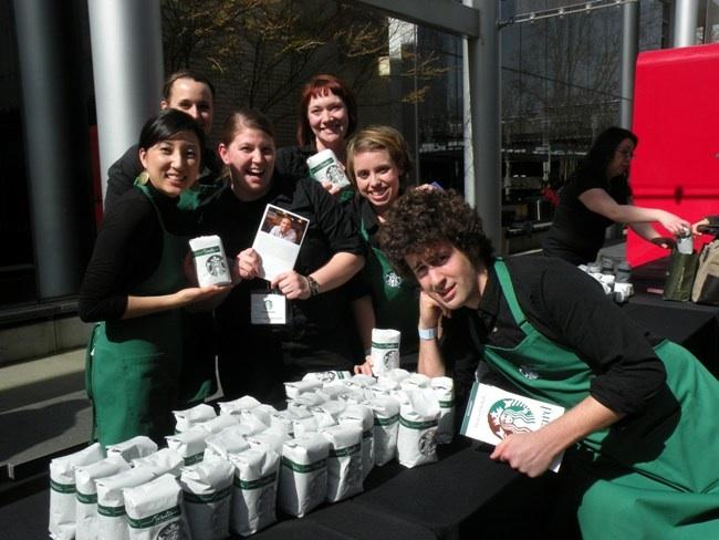 "Starbucks baristas who the company calls ""partners"" dole out coffee and memoires at the 2011 Annual Meeting, outside Benaroya Hall in Seattle."