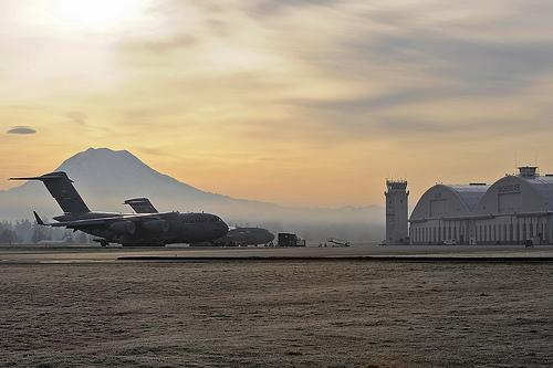 A C-17 Globemaster sits on the tarmac with Mt. Rainier in the distance at Joint Base Lewis-McChord in Lakewood.