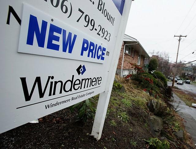 A sign advertises a new price on a home for sale in Seattle's Queen Anne neighborhood, Tuesday, Jan. 27, 2009.