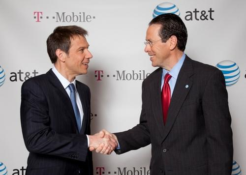 Deutsche Telekom Chairman and CEO Rene Obermann, left, and AT&T Chairman and CEO Randall Stephenson pose for photos in New York. AT&T Inc. said Sunday it will buy T-Mobile USA from Deutsche Telekom AG in a cash-and-stock deal valued at $39 billion