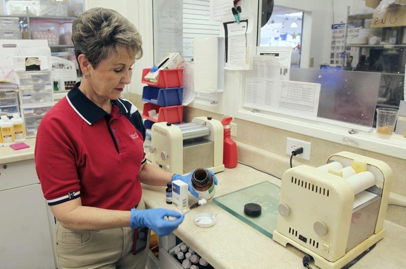 Pharmacist Donna Barsky measures potassium iodide for a prescription at the Texas Star Pharmacy on Tuesday, March 15, 2011 in Plano, Texas. The pharmacy has been receiving an unusually high number of calls about KI since the Japan quake.