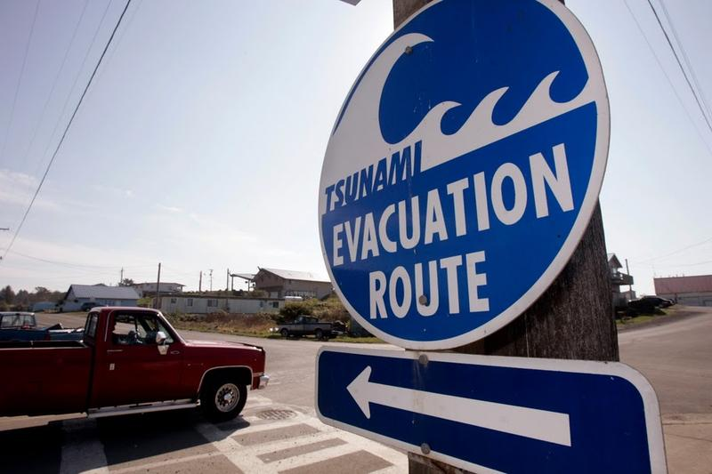 A tsunami evacuation sign in Grays Harbor County, on Washington's coast. There have been limited evacuations, as a surge of 4 feet is expected this morning.