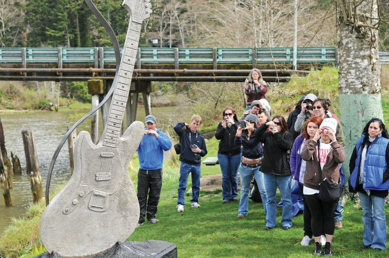 Kurt Cobain fans explore the underside of the Young Street Bridge in Aberdeen Tuesday. The spot is one of the few places fans can go to pay their respects to the musician, who died 17 years ago Tuesday.