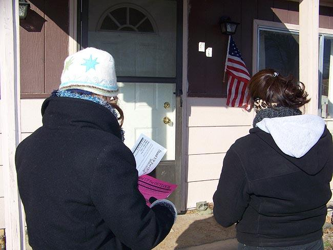 "Community activist ""Maria"" hands out flyers door-to-door in Outlook, Wash."