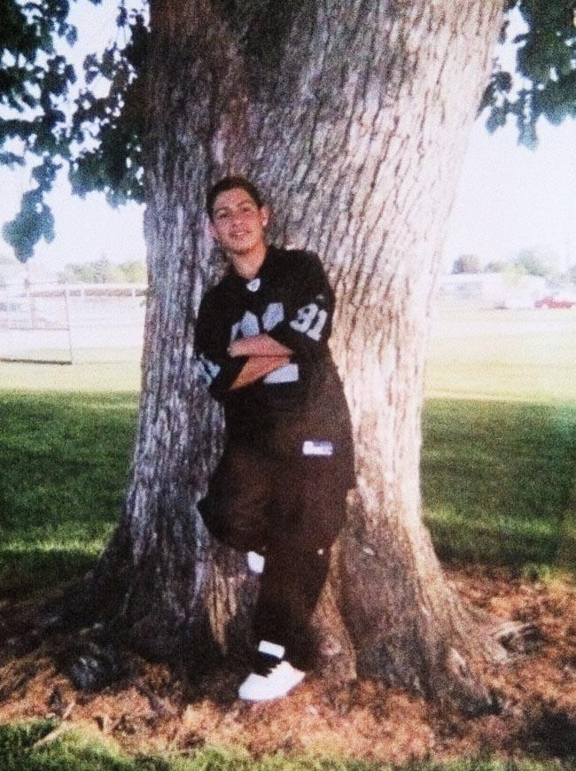 Alfonso Santos, age 14, wearing baggy pants and dark blue to represent his gang, the East Side Locos in of Caldwell, Idaho. He says he got rid of all his clothes when he decided to leave the gang.