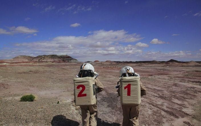 "Kavya Manyapu and a fellow crew member walk the surface of ""Mars"" - as replicated in the Utah desert."