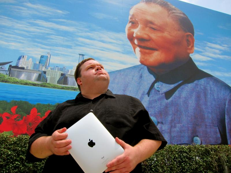 Mike Daisey—pictured here in front of a famous monument to Deng Xiaopheng, in Shenzhen, China—returns to Berkeley Rep with an audacious new monologue: The Agony and the Ecstasy of Steve Jobs.
