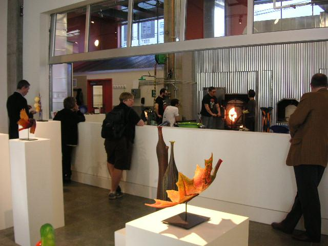 Visitors can watch glass blowing in the hot shop of the Schack Art Center's exhibit gallery.