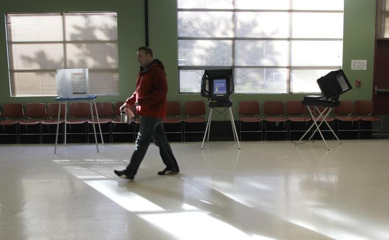 A man votes in at a Tacoma polling location last November. Pierce County's polling places are to be eliminated under a bill signed Tuesday by Gov. Chris Gregoire. It moves the state to vote-by-mail only.