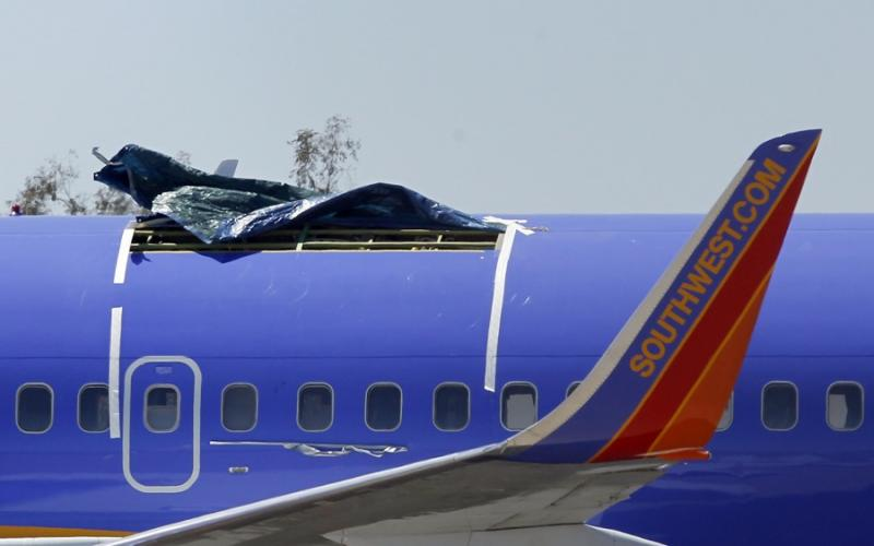 A Southwest Airlines plane sits in a remote area of the Yuma International Airport, after the plane had a section of fuselage tear from the plane during a flight on Friday, seen here Mon., April 4, 2011, in Yuma, Ariz.