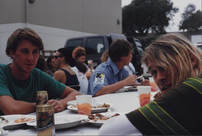 "Kurt Cobain (right) takes a break during production of the ""Smells Like Teen Spirit"" video in Los Angeles in 1991."