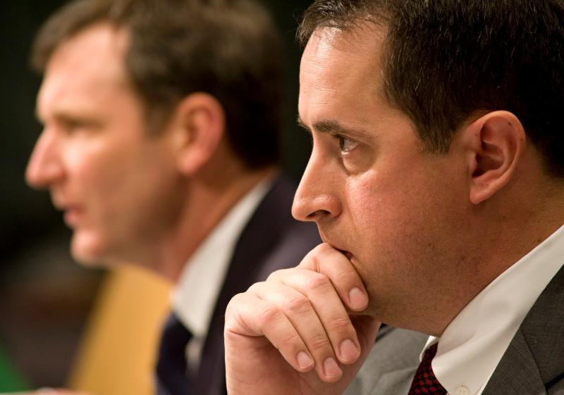 Former Washington Mutual Bank officials, David Beck, left, and David Schneider, shown testifying before the Senate subcommittee on Investigations on April 13, 2010. Schneider is named in a lawsuit that could end if a settlement is approved.