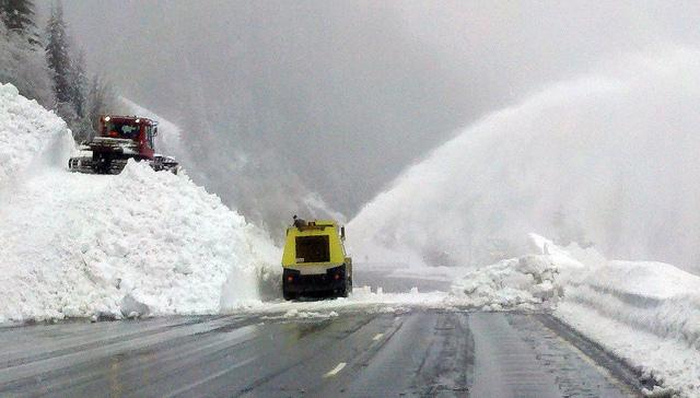 State transportation workers blow snow from US Hwy. 2 at the town of Scenic, near Stevens Pass, on Thursday. Avalanches closed the road early Thursday, and another hit yesterday afternoon. The pass remains closed today.