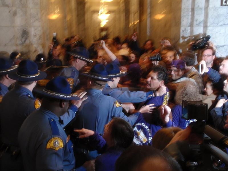 Union protesters are confronted by state patrol officers at the State Capitol building in Olympia, Wash., Thursday, April 7, 2011.