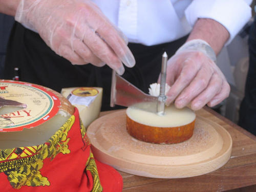 Here's a cheese maker making rosettes out of sheep cheese.