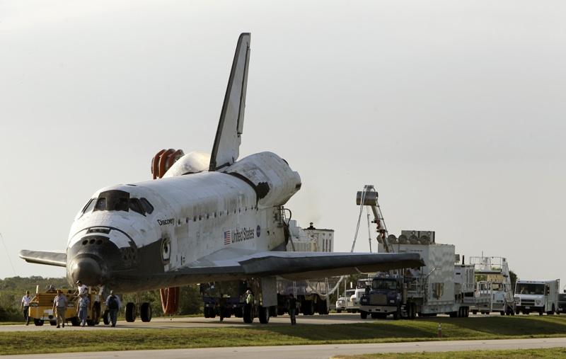 Space shuttle Discovery is towed to the Orbiter Processing Facility after landing at the Kennedy Space Center in Cape Canaveral, Fla., Wednesday, March 9, 2011.