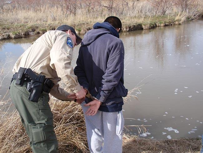 Washington State Department of Fish & Wildlife officer Chad McGary briefly detains a self-described gang member who was fishing with friends