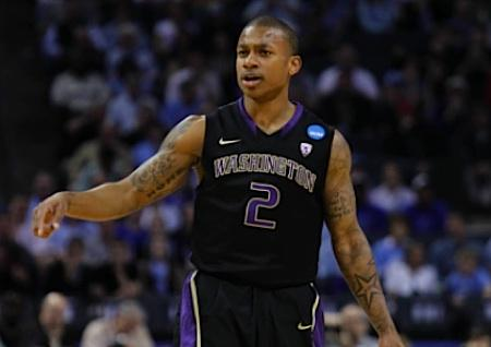 UW guard Isaiah Thomas moves the ball in the third round of the NCAA tournament against North Carolina on March 20, 2011. Art Thiel says Thomas should return to the UW for one more year instead of entering the NBA draft.