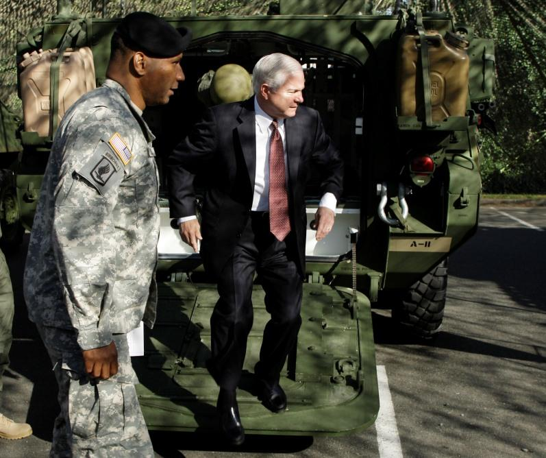 Defense Secretary Robert Gates, right, exits a Stryker combat vehicle, in 2008, during a visit to Fort Lewis, Wash. Col. Harry Tunnell, left, commander of the Army's 5th Stryker Brigade, 2nd Infantry Div., showed Gates various Styrker vehicles.