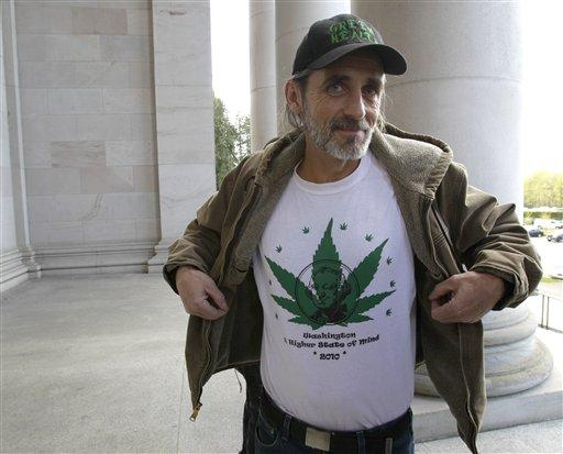 "Brian Pfister, owner of Green Health, which operates four medical marijuana dispensaries in western Washington, displays a shirt that reads ""Washington, a higher state of mind,"" last month, outside the Capitol in Olympia."