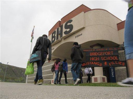 Students file into Bridgeport High School last Thursday. The school was one of three in the running for a commencement address by President Barack Obama, but lost out to a school in Memphis, Tenn.