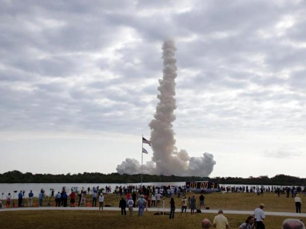 An exhaust cloud forms around Launch Pad 39A at NASA's Kennedy Space Center in Florida as space shuttle Endeavour soars into the sky. The shuttle is carrying a Ballard High School experiment.