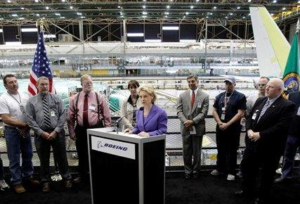 Gov. Chris Gregoire speaks Tuesday at the Boeing Co. assembly facility in Renton. Gregoire announced $3 million in funding to help workers develop the skills needed by aerospace employers such as Boeing.