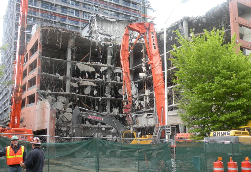 Demolition begins on the garage of the McGuire Apartments tower, in Seattle.
