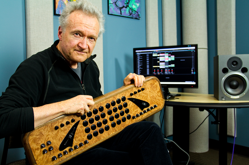 "KPLU music director, Nick Francis, poses with ""The Choppertone,"" a self-built MIDI controller which allows him to remix and mashup jazz tunes in real-time."