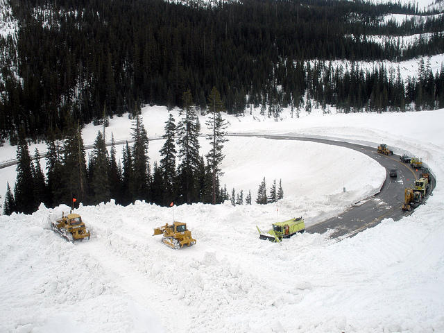 Snowplows work to clear the debris from a controlled avalanche covering the North Cascades Highway on May 10.